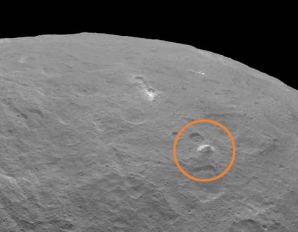 This image, taken by NASA's Dawn spacecraft on June 14, 2015, shows an intriguing mountain on dwarf planet Ceres protruding from a relatively smooth area. Image credit: NASA/JPL-Caltech/UCLA/MPS/DLR/IDA